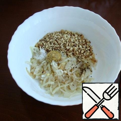 In a bowl, mix the fried onion with garlic, chopped walnuts, mustard, add salt and ground pepper. Mix everything until smooth.