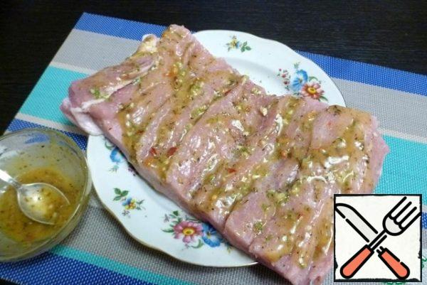 Brush with the prepared mustard-lime marinade with spices. Try to get the marinade into the cuts too.