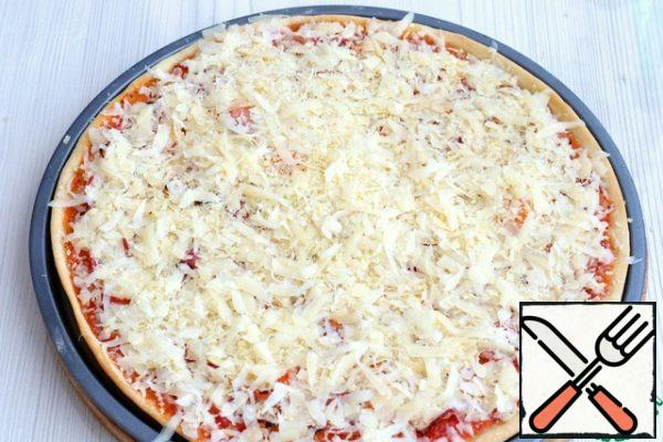 Then take out the form and sprinkle with a mixture of grated cheeses on top and send it back to the oven for 5-7 minutes.