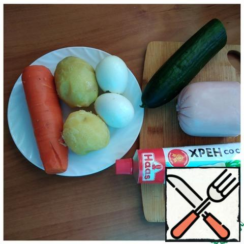 """Prepare food for a salad. Potatoes and carrots should be cooked in the """"uniform"""". Hard - boiled eggs. Peel potatoes and carrots."""