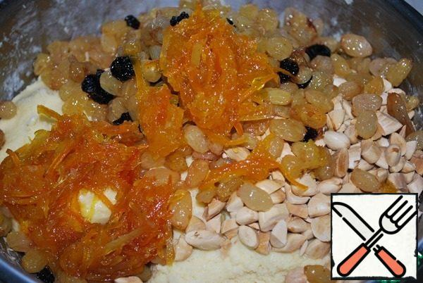 Add candied fruits and chopped almonds.