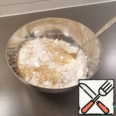Grind the nuts in a blender. Mix well with powdered sugar.