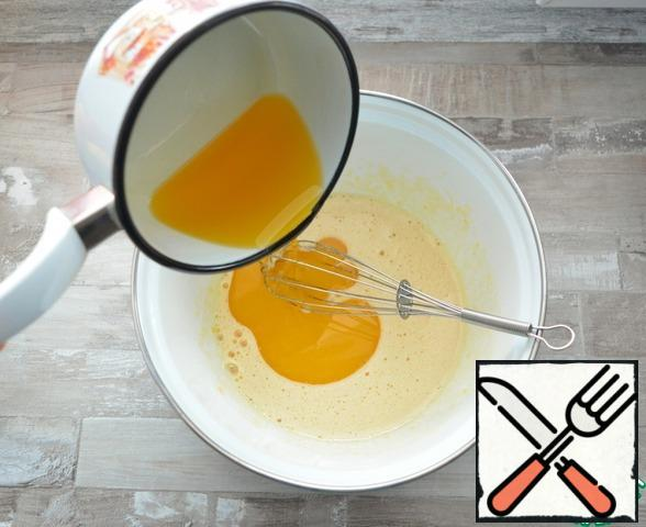 Pour in the melted butter and mix everything into a homogeneous mass
