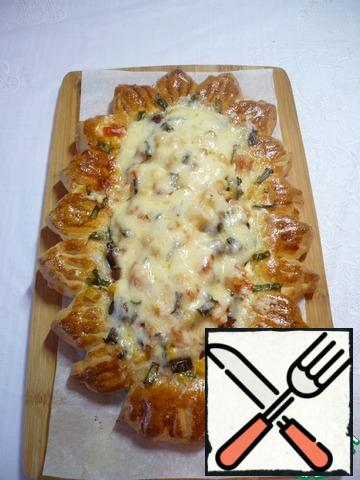 Five minutes before it is fully cooked, sprinkle all the pizzas with the remaining grated cheese.