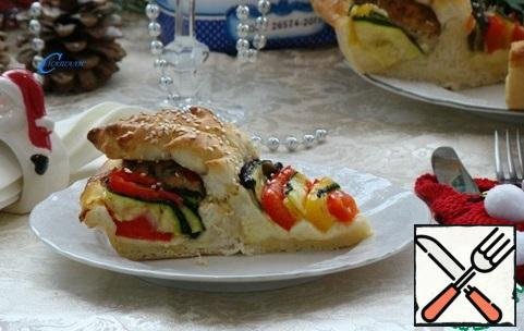 This cake will definitely appeal to both adults and children. Fragrant cutlet, juicy vegetables and stretching cheese-it is very tasty and satisfying.