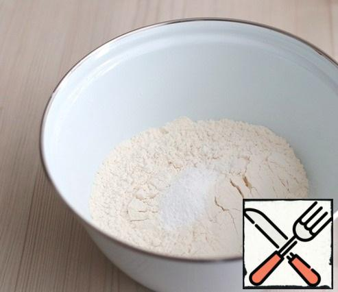 In a bowl, combine the flour (200 gr.) and baking powder (1 teaspoon). Mix the dry ingredients.