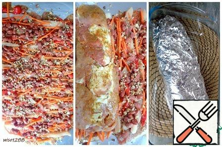 Top with the remaining garlic-nut mixture, salt, pepper. Preheat the oven to 180 degrees. Using foil, roll the meat and vegetables into a roll. Roll tightly wrapped in foil. Transfer to a baking dish. Bake for 50 minutes at 180 degrees.