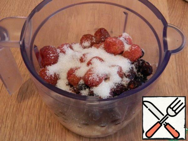 Add strawberries and sugar.