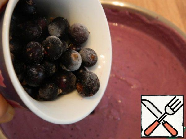 Remove from the heat and add a handful of whole frozen currants to preserve their integrity in the finished cheesecake.