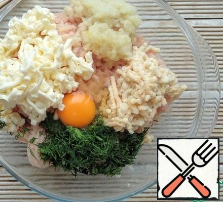 Next, add the melted cheese, grated on a coarse grater, chopped dill, egg, salt and ground pepper.