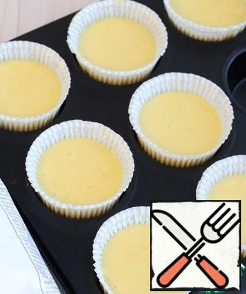 In the muffin baking dish, put the prepared batter for baking. The form is sent to a preheated oven to 160-170C for baking.