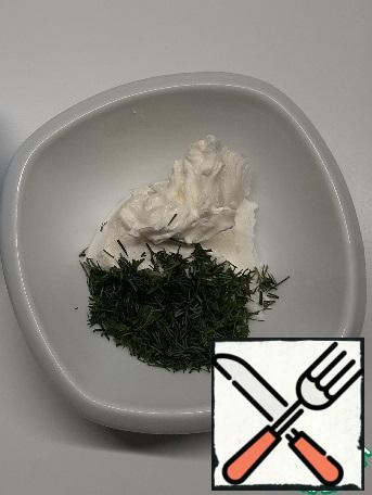Wash and dry the dill. Curd cheese mixed with finely chopped dill.