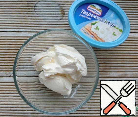 Mix cottage cheese with sour cream.