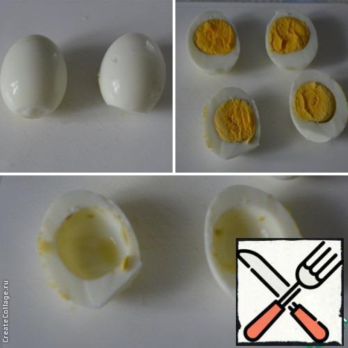 Hard-boiled eggs. Peel and cut in half. Get the yolk.