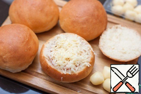 """Sprinkle with grated cheese (preferably low-melting, I have """"Scamortsa""""), cover the bun with the top and bake in the microwave for 45 seconds, power 800 Watts, then the egg will turn out """"in a bag"""" - the protein will grab, and the yolk will be creamy."""