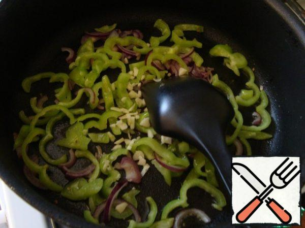 In a frying pan, pour olive oil and put the garlic, onion and then peppers. Slightly fry.