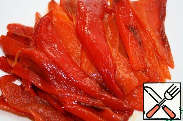 Put the peppers in a tightly closed plastic bag or cover with parchment and leave for 5 minutes. Then peel them. Cut the peeled peppers into wide strips.