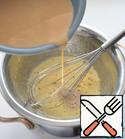 Rub the yolks with brown sugar, and put them in a water bath. Pour in the coffee mixture, stirring constantly.