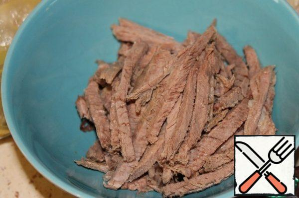 Cut the beef into strips.
