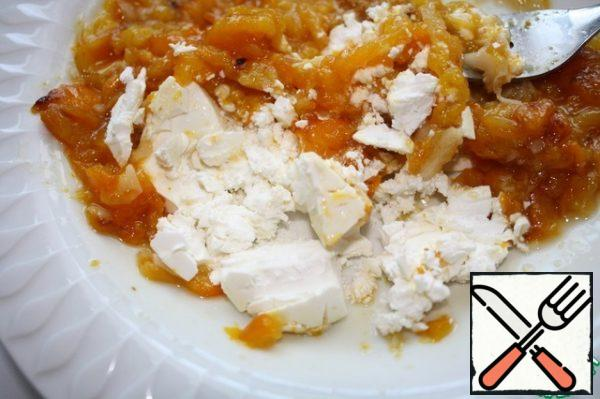 Use a fork to mash the garlic, pepper and feta.