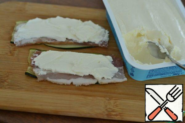 Spread a coffee spoon of cheese on the bacon .