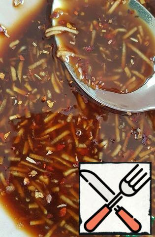 Mix soy sauce, finely chopped or passed through the press garlic, starch and ground hot pepper, or flakes (if you have fresh hot pepper, then chop finely.)
