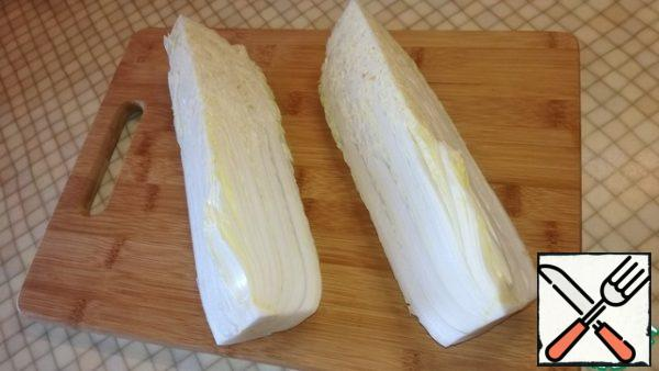 Peking cabbage cut into quarters, I prefer large, so I buy a large cabbage. Place on a large plate or bowl.
