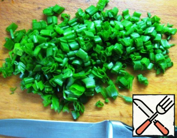 Boil the rice until tender. Cook and peel the eggs.Chop the green onions.