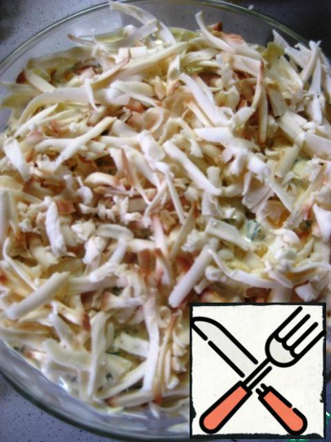 5. the final layer is grated sausage cheese.