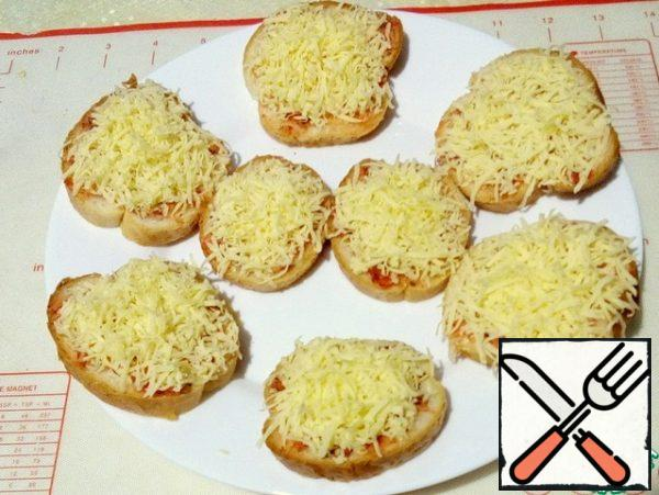 Top with grated cheese on a medium grater.