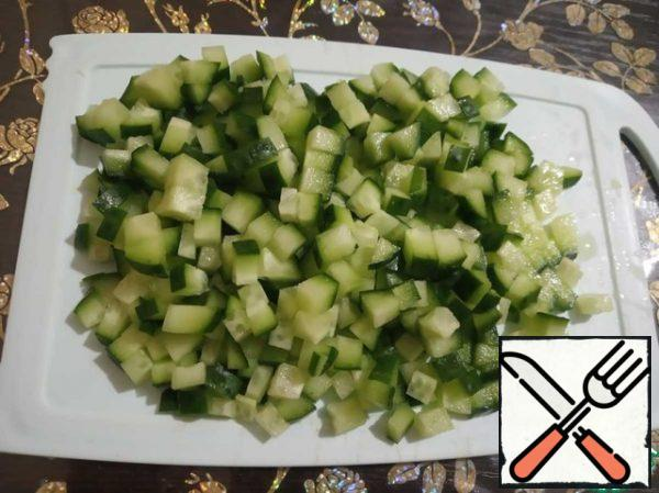 Cut into small cubes fresh cucumbers.