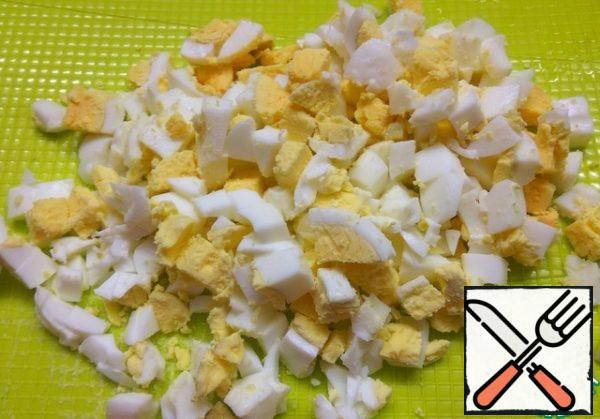 Hard-boiled eggs. Peel and cut into small pieces.