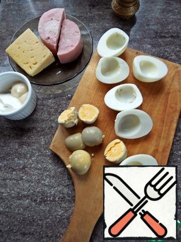 Split the peeled eggs in half, remove the yolk.