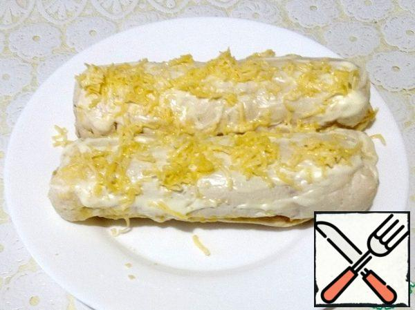Then remove the rolls, remove the film, sprinkle with grated cheese and send it to the oven for another 5 minutes to melt the cheese.