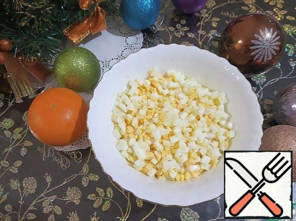 Boiled and chilled eggs are cut into small cubes.