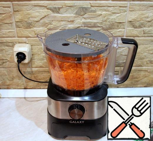 Grate the carrots with a grater attachment in a food processor.