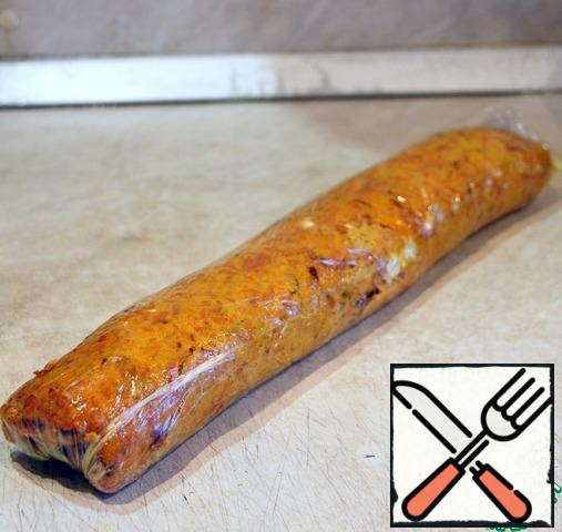 With the help of a film, roll it into a roll, wrap it in a film and put it in the refrigerator for 2-3 hours to stabilize. cut the finished roll into pieces.