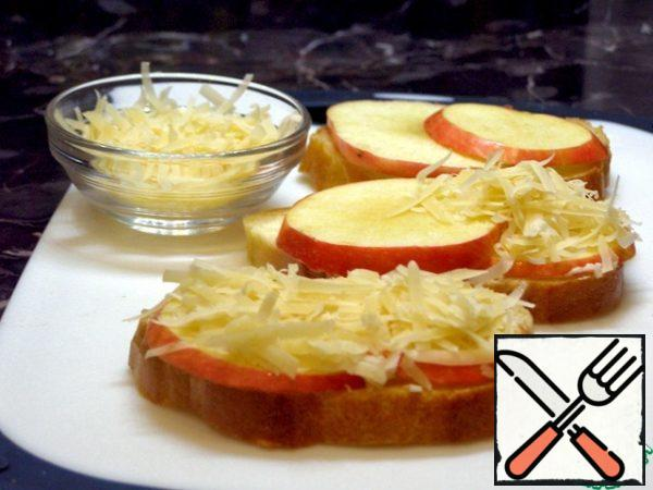 On the bread we put plates of apples, and on them - grated cheese. Fry the sandwiches in a preheated frying pan, not fully covered with a lid. When the cheese starts to melt, sprinkle with nuts on top. These sandwiches should be eaten hot, they are especially delicious with aromatic coffee.