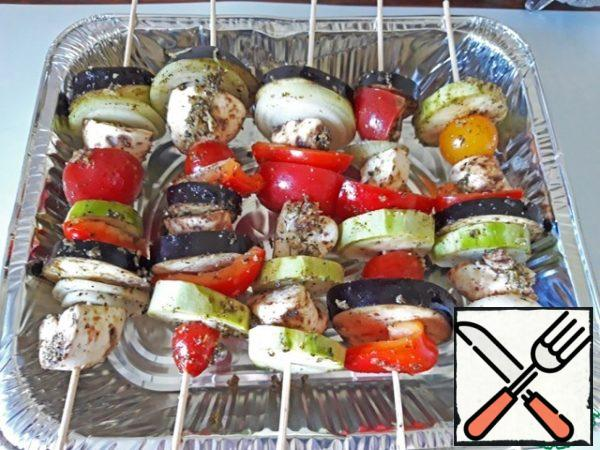 Vegetables are strung on skewers, bake over a baking dish in the oven at 180 degrees for about an hour, on the grill - until ready. Serve with your favorite sauce as an independent dish or side dish to meat.
