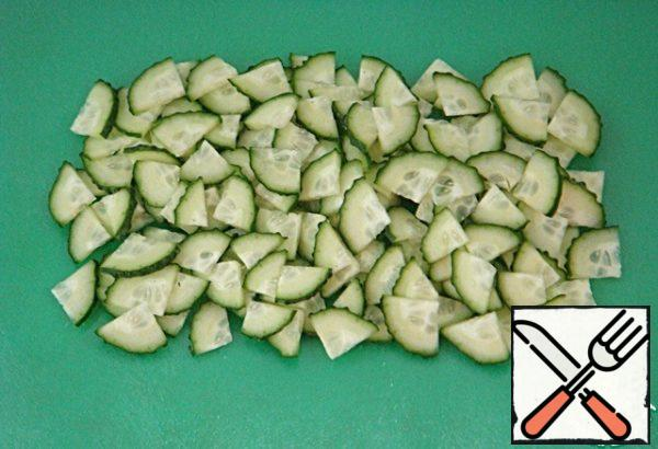Cut the cucumbers lengthwise into four pieces, then crosswise into thin slices.