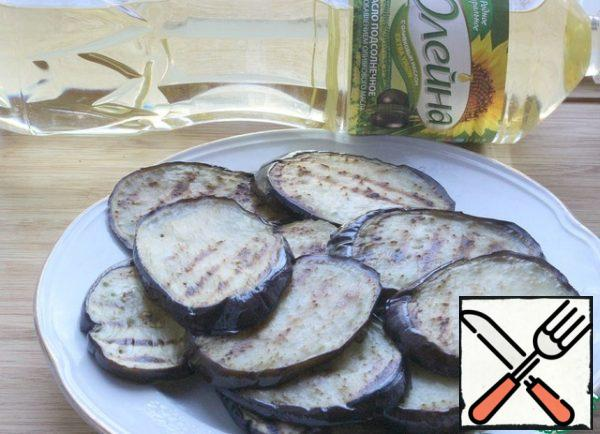 Add the fried eggplants to a platter and cool slightly.
