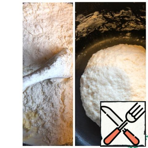 Add flour and knead the elastic dough. Cover and leave in a warm place for 1.5 hours until the dough increases in volume.