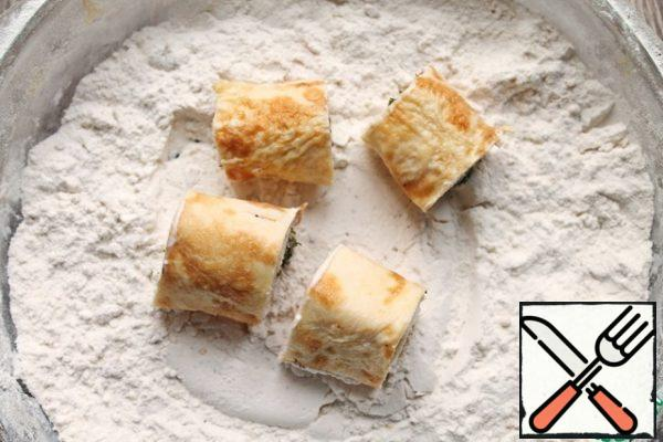 Roll them in flour.