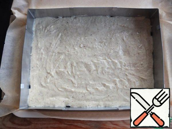 In a baking sheet covered with baking paper, spread the dough and level it. For convenience, I used a split form - 35*25 cm. Bake in a preheated 180 degree oven for 15-20 minutes.