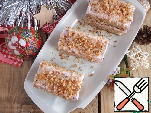 Before serving, cut into small portion cakes and sprinkle with either nuts or the remains of a sponge cake, crushed into crumbs.