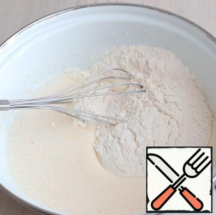 Then add the total amount of flour (160 gr.). Beat the mixture with a whisk until smooth and homogeneous.