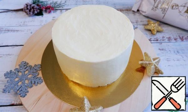 Using a pastry bag, coat the cake with cream. Straighten the cake and refrigerate for 2 hours (preferably overnight).