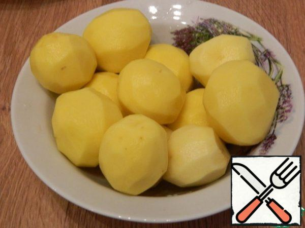 Peel the potatoes for a side dish.
