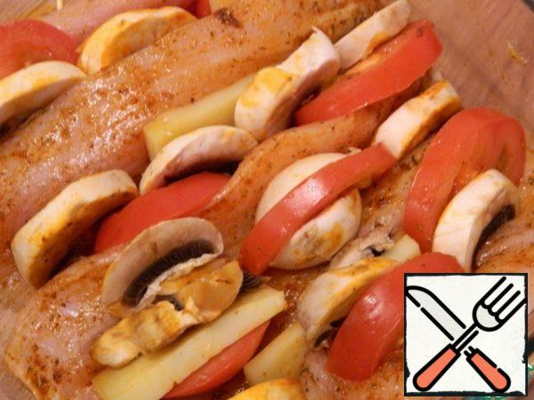 Insert sliced mushrooms, tomatoes, cheese into the turkey cuts.