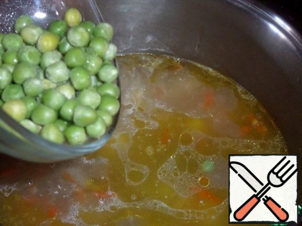 Add green peas to the pan.